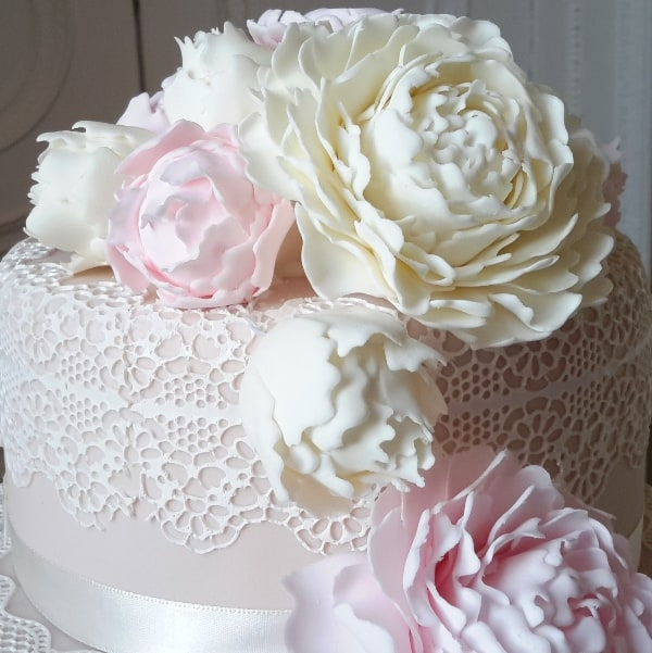 Peony on lace wedding cake detail
