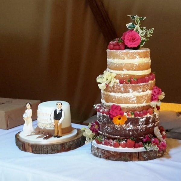 traditional wedding cake alongside rustic naked cake