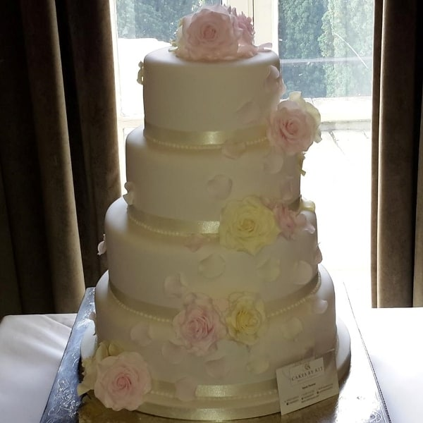 Delicate blush pink & ivory rose wedding cake